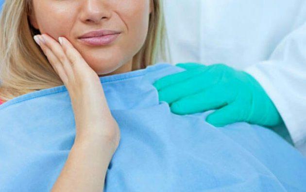 Диагностика причины боли в деснах